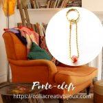 porte-clefs dore orange